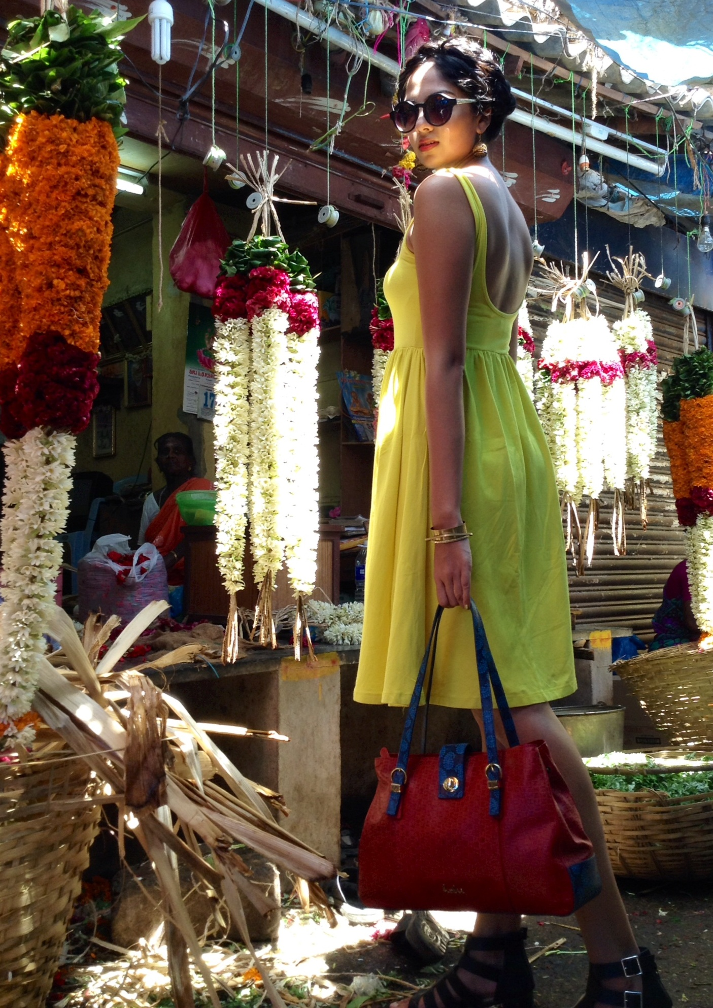 Holii's creative head with Tamarind shoulder bag