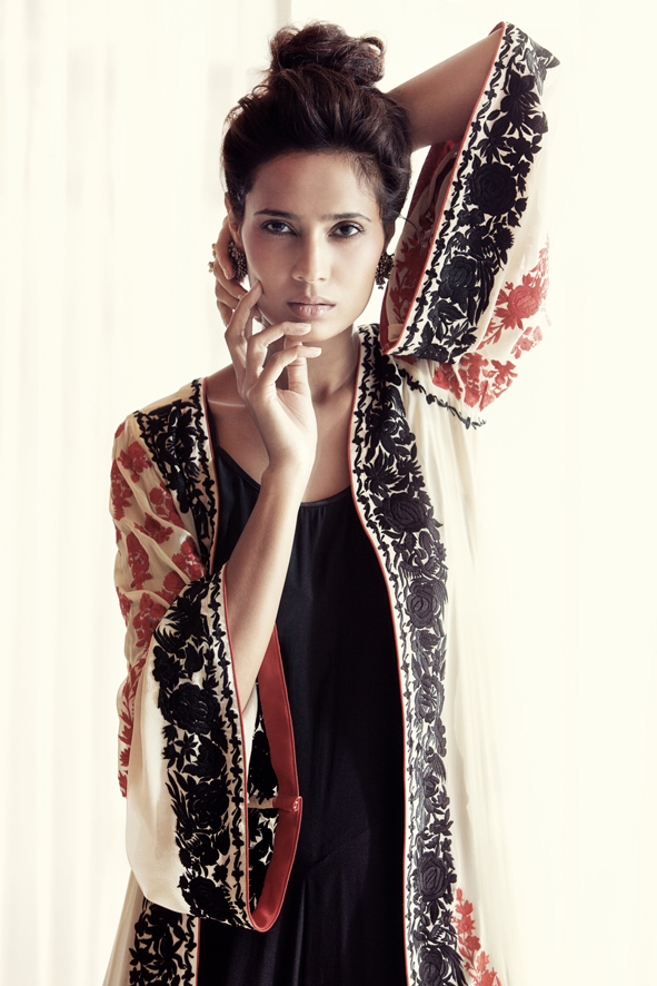 Black jumpsuit with ivory Parsi jacket by Pallavi Puri
