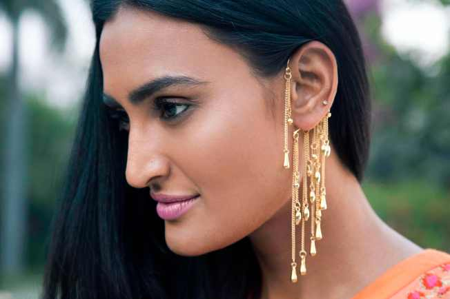 Gold Hanging Ear Cuffs by Payal Pratap.