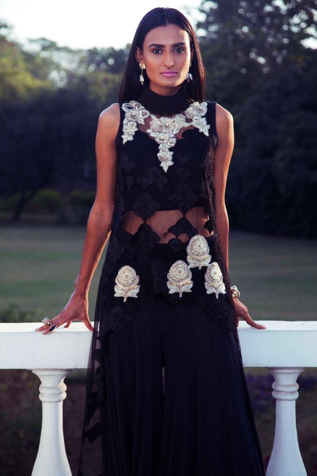Gold & Black Sharara Dress by Kavita Bhartia. Kundan Cuff by Vasundhara Mantri. Carbon Lace Triple Ring by Atelier Mon.Earrings by Eesha Zaveri.