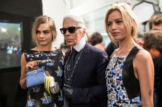 Cara Delevingne, Karl Lagerfeld showcasing FENDI micro bag