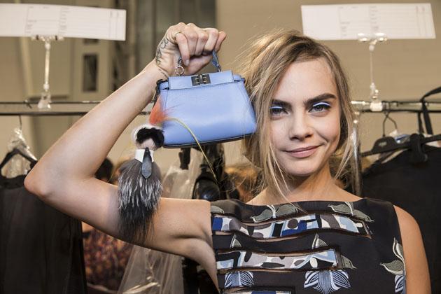Karl Lagerfeld, Cara Delevingne showcasing a FENDI micro bag