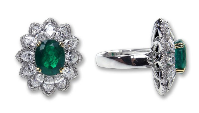 Entice cocktail ring with oval emerald center and surrounding marquise diamonds